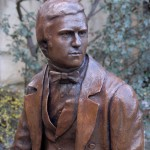 Bronze statue sculpture of the naturalist Charles Darwin by artist Anthony Smith for Christ's College Cambridge University