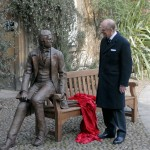 Bronze statue sculpture of the naturalist Charles Darwin by artist Anthony Smith being unveiled by HRH Prince Philip for Christ's College Cambridge University