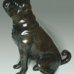 Bronze sculpture of a Pug dog by artist Anthony Smith