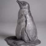 Bronze sculpture of a Gentoo Penguin Chick by artist Anthony Smith