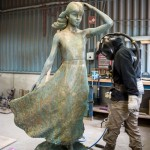 Bronze statue sculpture of a young Girl with a Flowing Dress by artist Anthony Smith at the foundry
