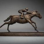 Bronze sculpture of a jockey and Racehorse by artist Anthony Smith