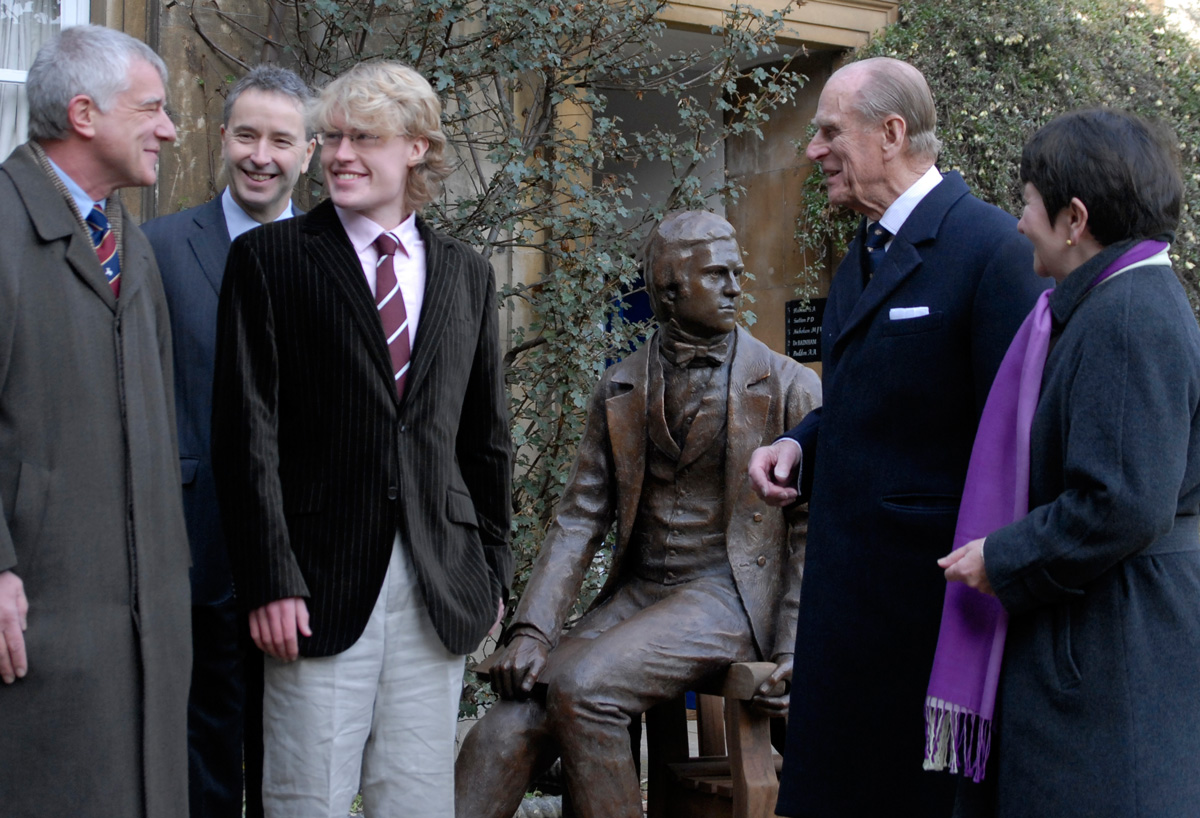 HRH Prince Philip unveiling Anthony Smith's statue of the Young Darwin for Christ's College Cambridge University