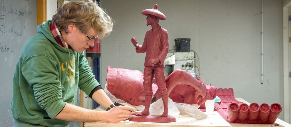 Artist Anthony Smith working on the wax stages for several sculptures