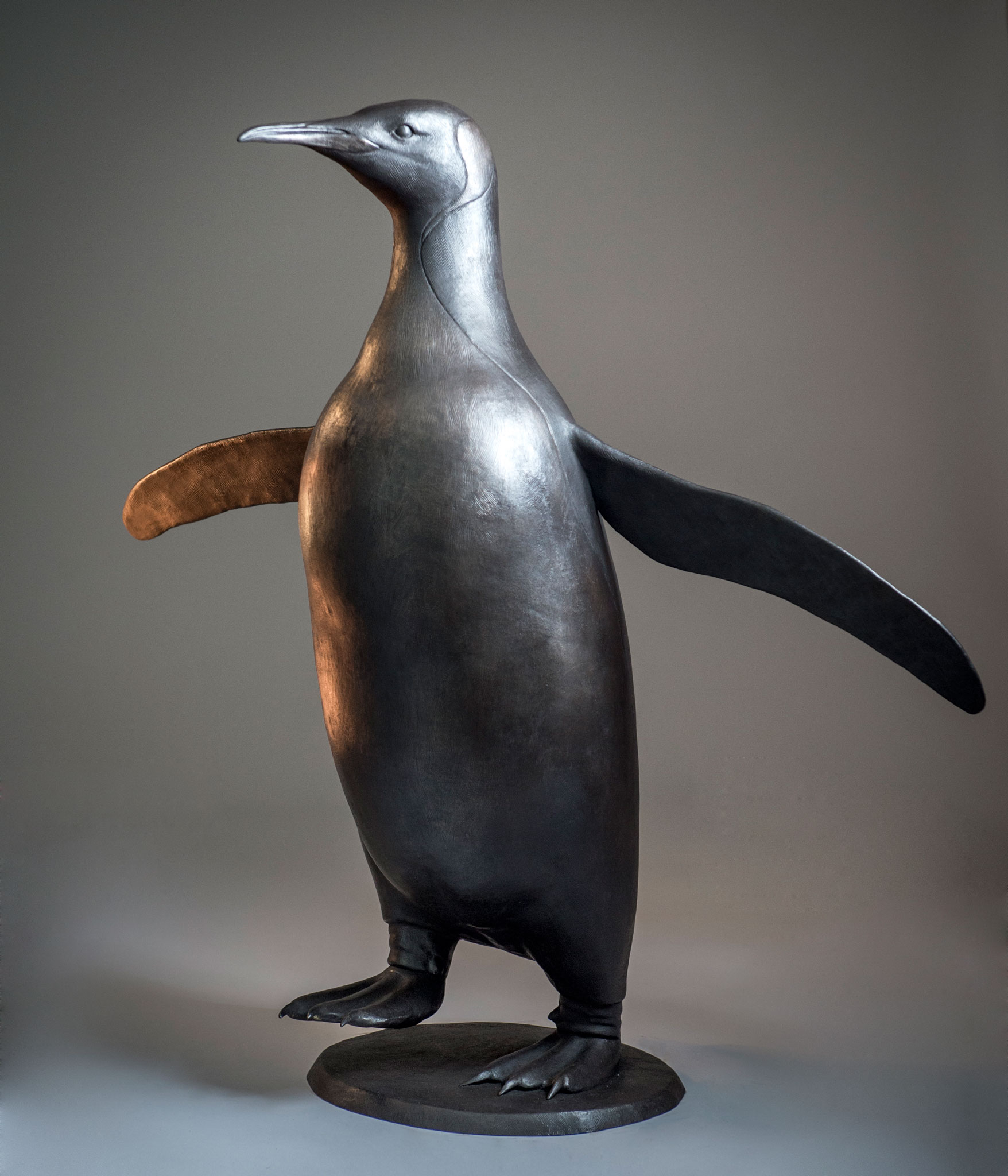 Life size bronze sculpture of a King Penguin by artist Anthony Smith