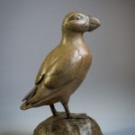 Bronze sculpture of a standing Atlantic Puffin by artist Anthony Smith