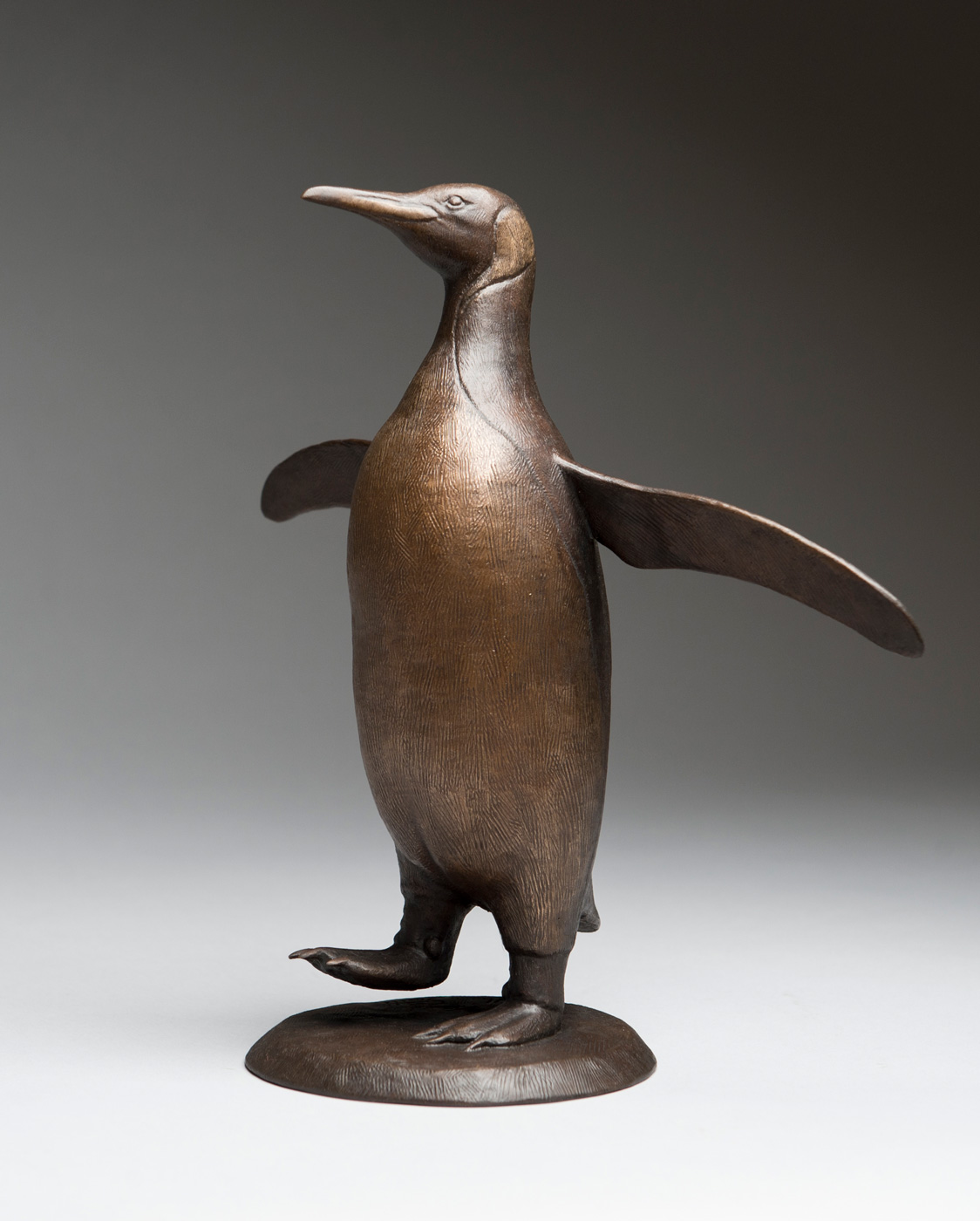 Bronze sculpture of a King Penguin (Small) by artist Anthony Smith