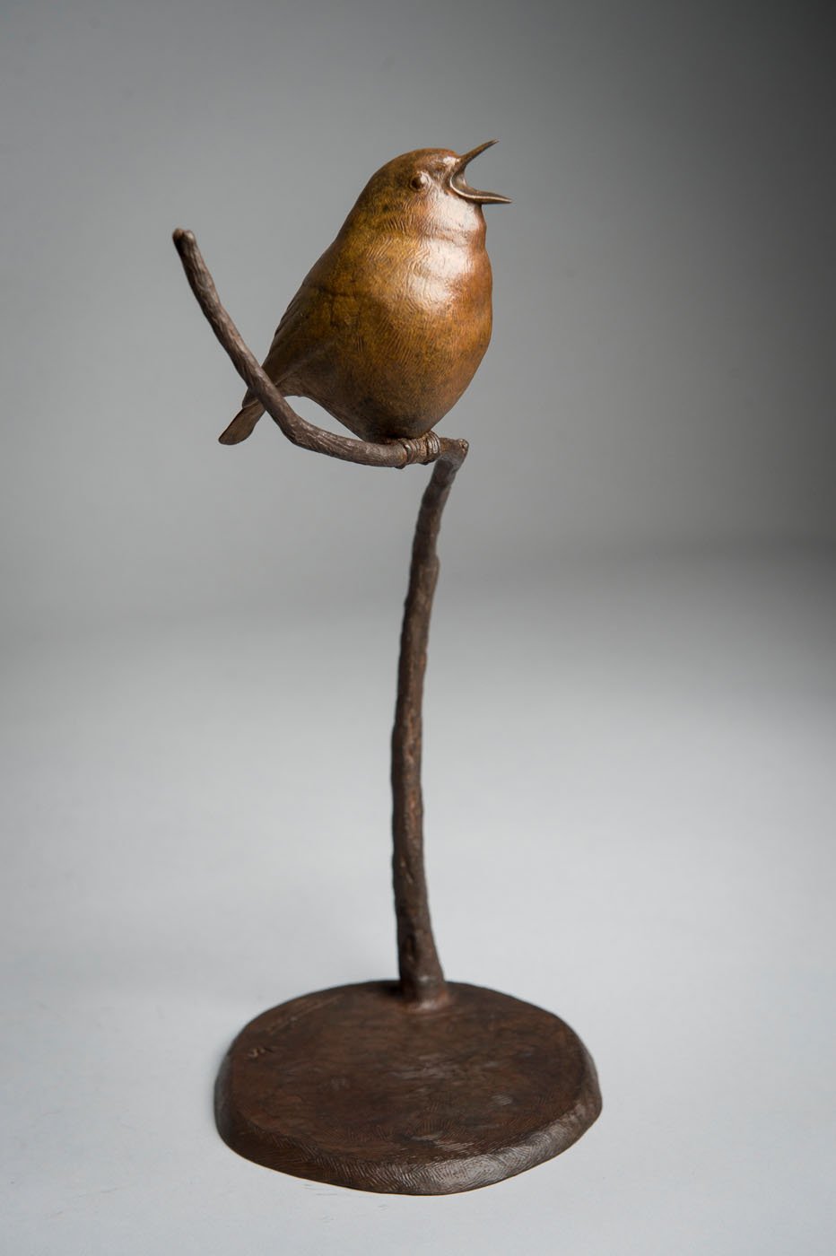 Bronze sculpture of a singing Robin bird by artist Anthony Smith