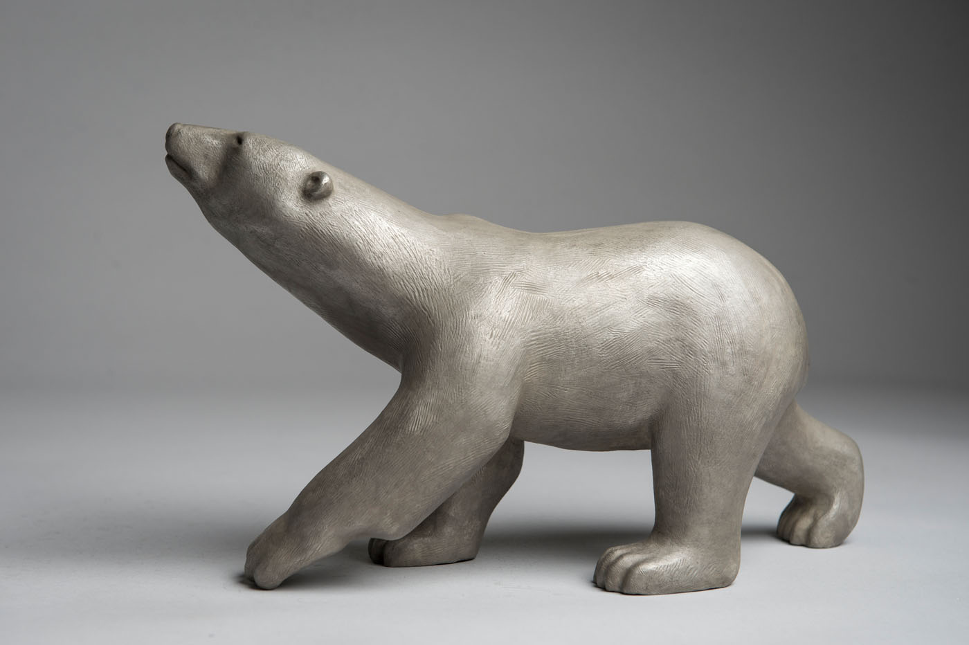 Bronze sculpture of a Scenting Polar Bear with a silver patina by artist Anthony Smith