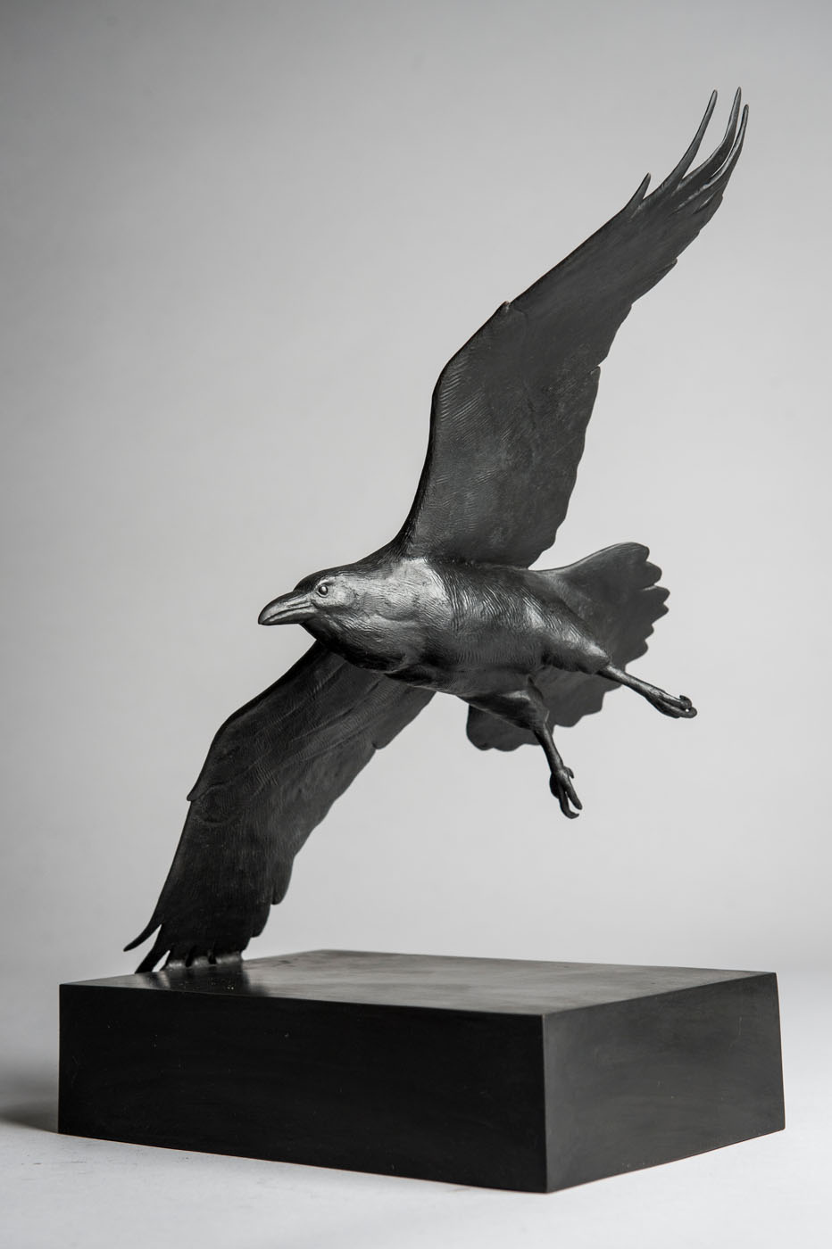 Bronze sculpture of a flying Raven by artist Anthony Smith