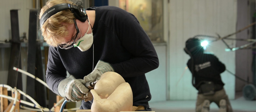 Sculptor Anthony Smith working on the bronze stage of his Albatross Couple sculpture