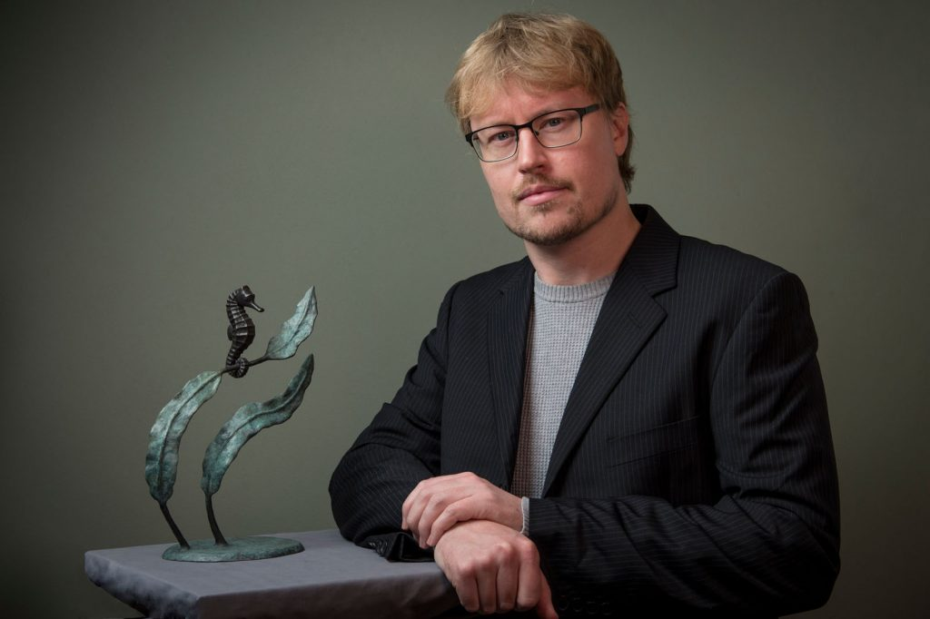 Artist Anthony Smith with his bronze sculpture of a Sea Horse
