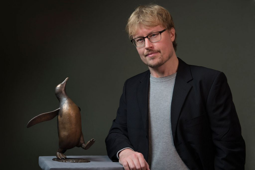 Sculptor Anthony Smith with his Gentoo Penguin sculpture