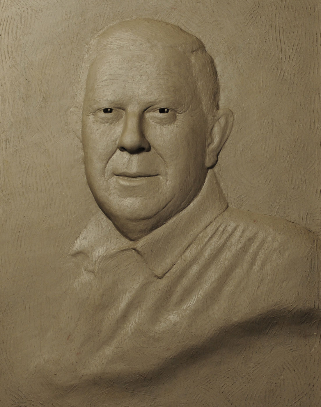 Clay relief portrait bust sculpture of the philanthropist Dr Yusuf Hamied by the artist Anthony Smith